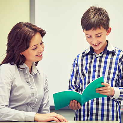 Student reading to his teacher